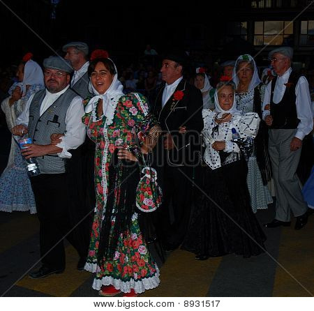 Chulapos and chulapas in streets of Latina