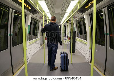 Man with Suitcase on an empty train.