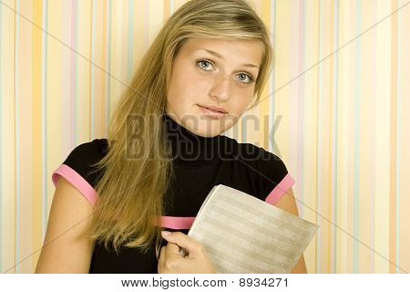 Girl with music printed music sheets