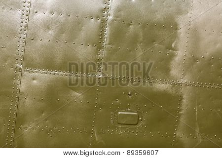 Abstract painted khaki metal background with rivets. Riveted military green texture. poster