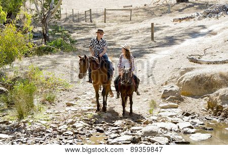 Young Father As Horse Instructor Of Young Teen Daughter Riding Little Pony Wearing Cowgirl Hat