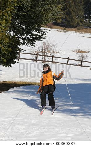 Inexperienced Boy Trying The Cross-country Skiing  And Then He Falls On Snow