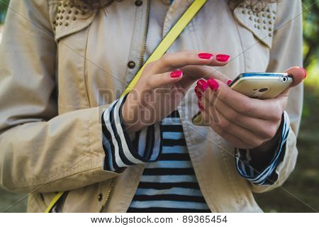 The Girl Uses The Phone Close Up