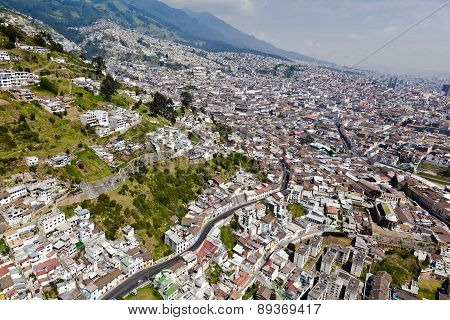 Quito, Ecuador - April- 2014: Aerial view of colonial town of Quito with the skirts of Panecillo