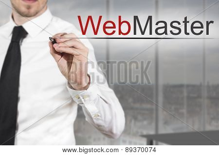 Businessman In Office Writing Webmaster In The Air