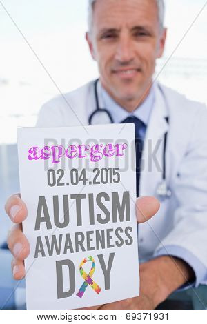 The word asperger and portrait of a male doctor showing a blank prescription sheet against autism awareness day