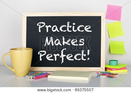 Practice makes perfect note phrase on chalkboard poster