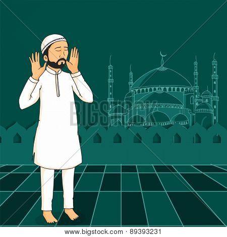 A Muslim man praying (reading Namaz, Islamic Prayer) on Mosque decorated green background for holy month Ramadan Kareem celebration.