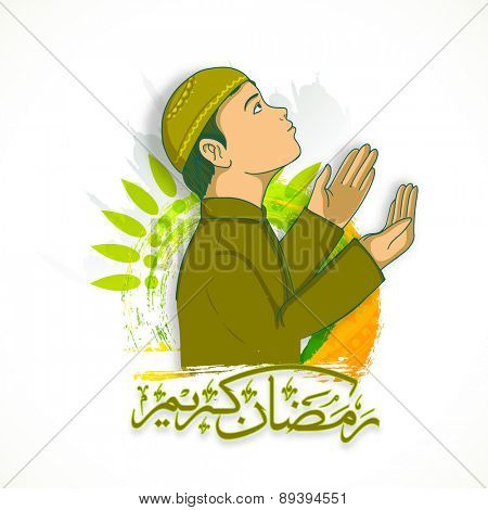 Religious Muslim boy offering Namaz (Islamic Prayer) and Arabic Islamic calligraphy of text Ramazan Kareem (Ramadan Kareem) for Muslim community festival celebration.