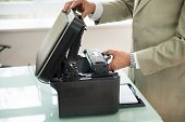 Close-up Of Businessman Fixing Cartridge In Photocopy Machine In Office poster
