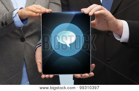 business, technology and internet concept - businessman and businesswoman with blank black tablet pc screen