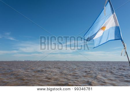 Sailing Buenos Aires City. Argentinean Flag Waving At Rio De La Plata.