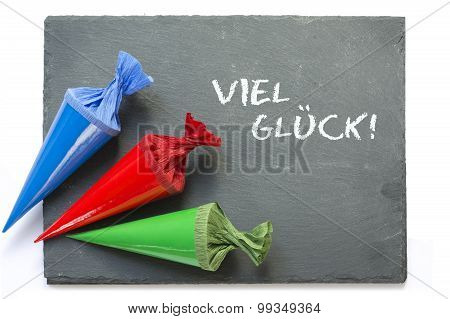 School Cones On A  Blackboard With Message Good Luck