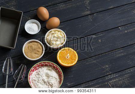 Raw Ingredients - Flour, Eggs, Butter, Sugar, Orange - To Cook Orange Cake. Ingredients For Baking.