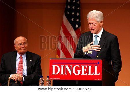 Former President Bill Clinton And Congressman John Dingell