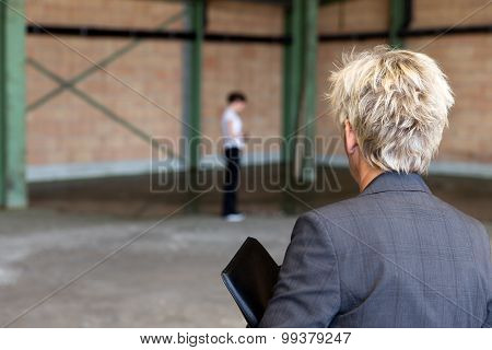 Business Woman Is Inspecting A Warehouse