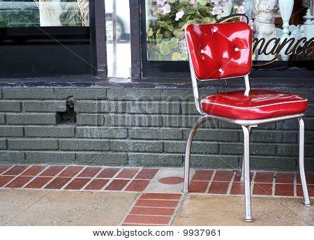 Red Chair on Sidewalk