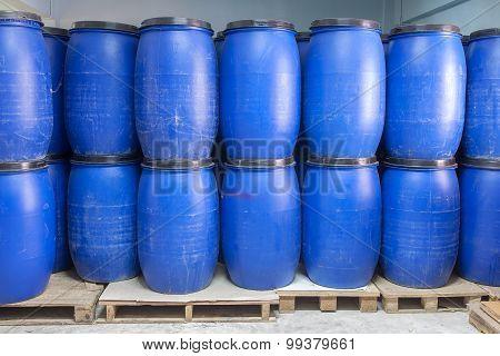 Blue Plastic Barrels Contain Chemical Inside