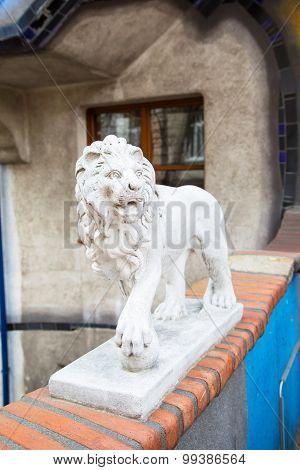 Lion Statue - Detail Of Hundertwasser House In Vienna, Austria