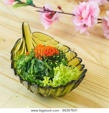 Traditional japanese food Hiyashi wakame (Cold seaweed) on wooden background poster