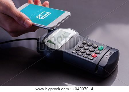 Mobile screen showing payment successful against man using smartphone to express pay
