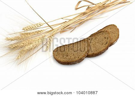 The Ears Of Wheat And Three Pieces Of Bread Which Are Laid Out In A Row A Still Life