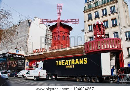 PARIS, FRANCE - MARCH 19, 2014: The famous Moulin Rouge cabaret theatre in the Boulevard de Clichy in the Pigalle district of Paris. First opened in 1899, the current building dates from 1921.