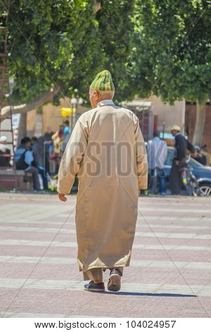 TAROUDANT, MOROCCO, APRIL 9, 2015:Senior local men in traditional attire walks outdoor