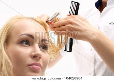 The woman in the chair barber styling during surgery