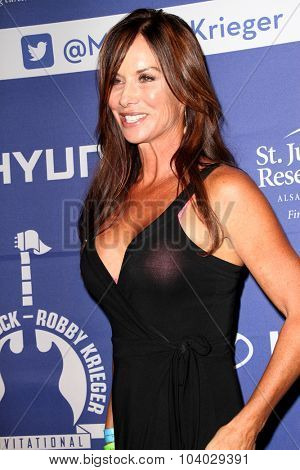 MOORPARK, CA - OCT 5: Debbe Dunning arrives at the 8th Annual Medlock/Krieger Invitational Golf Concert at the Moorpark Country Club in Moorepark, CA on October 5, 2015.