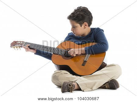 Cute little boy playing guitar isolated on white background.