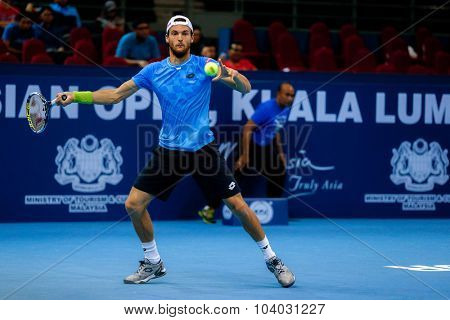 KUALA LUMPUR, MALAYSIA - SEPTEMBER 30, 2015: Joao Sousa of Portugal hits a forehand return in his match at the Malaysian Open 2015 Tennis tournament held at the Putra Stadium, Malaysia.