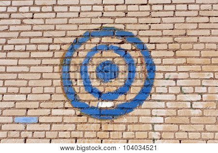 Blue Painted Target On Brick Wall.