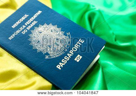 Brazilian passport on the brazilian flag