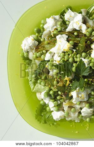 Salad with cream cheese and young peas