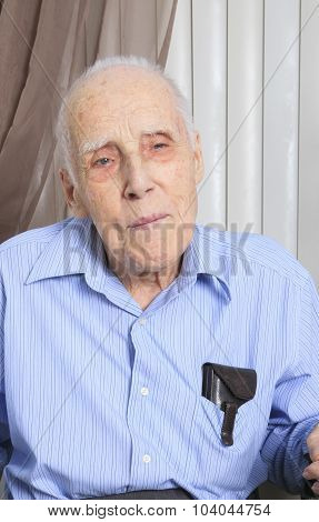 An old men smiling on his room