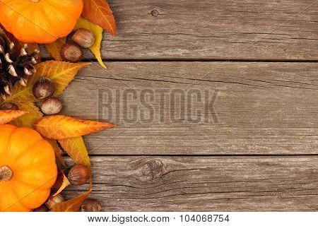 Autumn side border against rustic wood