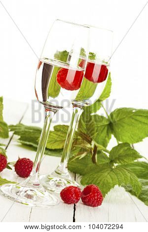 Two glasses of Himbeergeist, german fruit schnaps made from raspberries