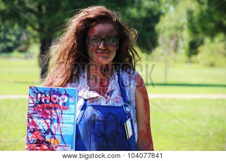 MUSKOGEE, OK - Sept. 12: An actor dressed as a zombie hides in a field and waits for the next runner during the Castle Zombie Run at the Castle of Muskogee in Muskogee, OK on September 12, 2015.
