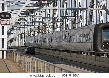 Train And Cars On Bridge