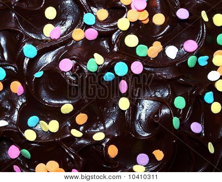 Chocolate frosting with confetti sprinkles