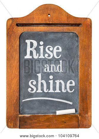 Rise and shine- white chalk text  on a small slate message blackboard isolated on white