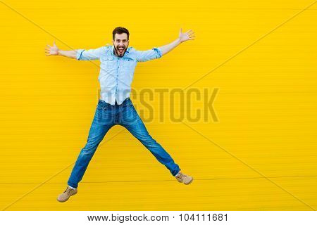 Men Jumping On Yellow Background
