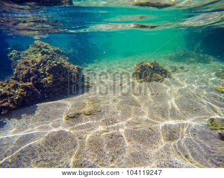 Rocks, Seaweeds And Sand In Sardinia