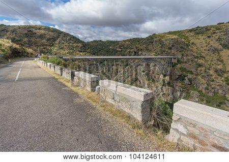 Road to Requejo iron Bridge, Castile and Leon, Spain