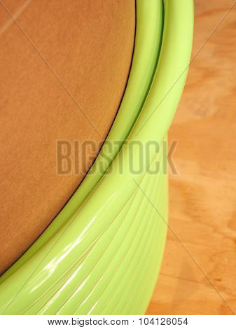Winding layer of green fiber optic cable on a cardboard core
