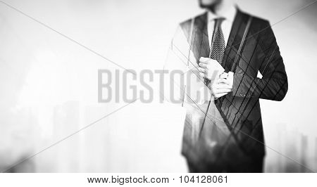 BW double exposure of young business man in the skyscraper on a background