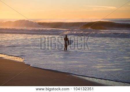Surfer About To Paddle Out