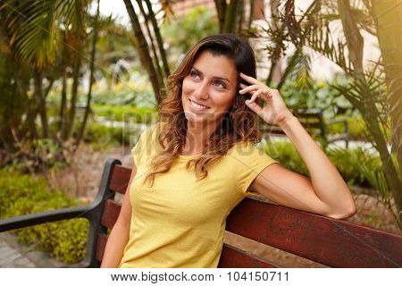 Pensive Woman Looking Away While Sitting On Bench