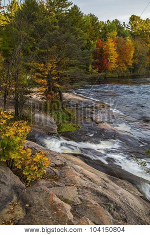 The rocky shoreline downstream from Mary Lake in autumn.
